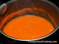 Add pureed tomatoes