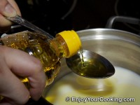 Mix milk, oil and salt in cooking pot