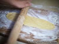 Roll a dough ball into thin long sheet