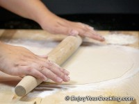 Roll it 2-3 mm thin with a rolling pin
