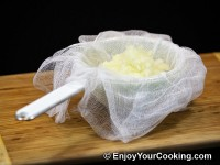 Put chopped onions into cheesecloth