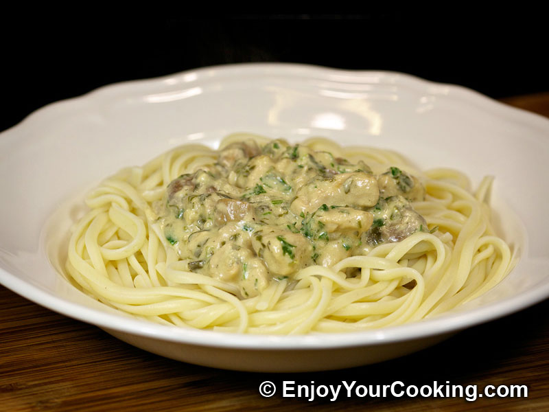 Creamy chicken and mushroom sauce with feta cheese and parsley will ...