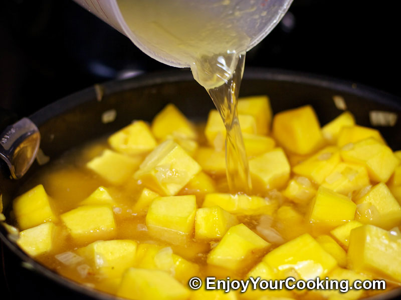 ... to a cooking pot: Pumpkin and Rice Soup Puree Recipe: Step 9 Add rice